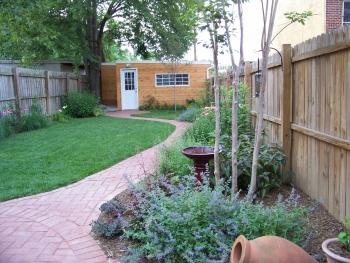 garden spot july the garden has winding paths and lush borders a real backyard oasis photo derek thomas - Garden Spot