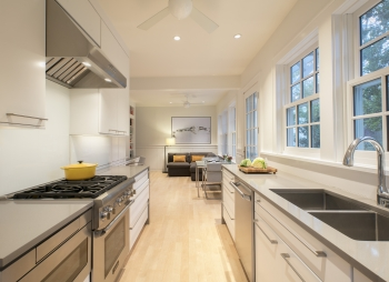 Galley kitchen gets an update capital community news for Pictures of updated galley kitchens