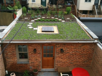 The hill gardener capital community news for Garage with deck on top